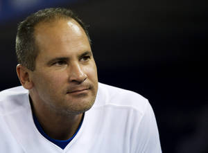 Photo -   Toronto Blue Jays infielder Omar Vizquel looks out from the dugout during the eighth inning of a baseball game against the Minnesota Twins in Toronto on Tuesday, Oct. 2, 2012. (AP Photo/The Canadian Press, Nathan Denette)
