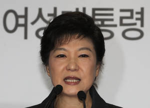 "photo - South Korea's president-elected Park Geun-hye speaks during a press conference at the headquarters of Saenuri Party in Seoul, South Korea, Thursday, Dec. 20, 2012. Park was elected South Korean president Wednesday, becoming the country's first female leader despite the incumbent's unpopularity and her own past as the daughter of a divisive dictator. The letters read "" Female President."" (AP Photo/Ahn Young-joon)"