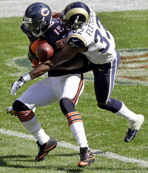 Photo -   St. Louis Rams cornerback Bradley Fletcher (32) breaks up a pass intended for Chicago Bears wide receiver Brandon Marshall (15) in the second half of an NFL football game in Chicago, Sunday, Sept. 23, 2012. (AP Photo/Kiichiro Sato)