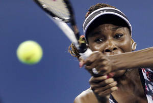 Photo -   Venus Williams keeps her eyes on the ball as she returns to Angelique Kerber, of Germany, in the second round of play at the U.S. Open tennis tournament, Thursday, Aug. 30, 2012, in New York. (AP Photo/Charles Krupa)