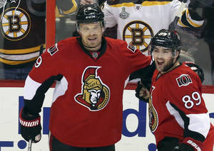 Photo - Ottawa Senators' Cory Conacher (89) celebrates his goal against the Boston Bruins with teammate Milan Michalek (9) during the first period of an NHL hockey game in Ottawa, Ontario on Saturday, Dec. 28, 2013. (AP Photo/The Canadian Press, Fred Chartrand)