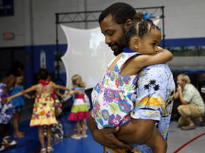 Photo - Jamaal Jackson dances with his daughter Julia, 4, during a Daddy-Daughter Dance at the Moore Community Center on Saturday. <strong>SARAH PHIPPS - SARAH PHIPPS</strong>