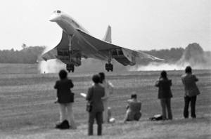 Photo - FILE - In this May 24, 1976 photo an Air France Concorde SST lands at Dulles International Airport to inaugurate commercial passenger service between Paris and Washington. Earlier British Airways Concorde landed from London.  When the Concorde started flying in the 1970s, hopes were high that the traveling masses would soon streak through the air faster than the speed of sound or soar in planes that hurtled like missiles above the earth's atmosphere. Instead, jetliners still look the same as they did five decades ago and travel times have barely budged. (AP Photo)