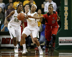 Photo - Baylor guard Odyssey Sims (0) reaches out to grab a pass under pressure from Texas Tech's Amber Battle (12) in the first half of an NCAA college basketball game, Wednesday, Jan. 29, 2014, in Waco, Texas. (AP Photo/Tony Gutierrez)