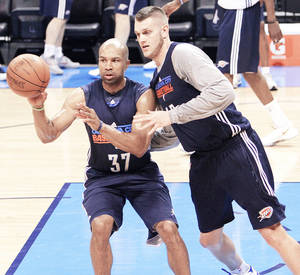 Photo - Oklahoma City's Derek Fisher, left, and Cole Aldrich go through drills during the NBA Finals practice at the Chesapeake Energy Arena on Monday.  Photo by Chris Landsberger, The Oklahoman