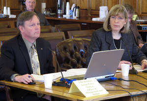 Photo -   John Boucher and Karen Rehfeld with the Office of Management and Budget appear before the House Resources Committee and House Special Committee on Energy on Wednesday, April 25, 2012, in Juneau, Alaska. Testimony was on the potential impact of the governor's oil tax bill on the state budget. (AP Photo/Becky Bohrer)