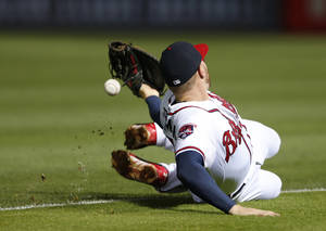 Photo - Atlanta Braves first baseman Freddie Freeman can't reach an RBI single by Boston Red Sox's Jonny Gomes in the seventh inning of a baseball game Tuesday, May 27, 2014, in Atlanta. (AP Photo/John Bazemore)