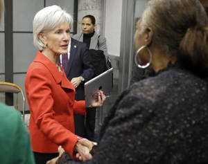 Photo - FILE - In this Feb. 3, 2014 file photo, Health and Human Services Secretary Kathleen Sebelius greets visitors after a news conference on enrollment in affordable health coverage in Cleveland. The Obama administration says about 1 million Americans signed up for private insurance under the president's health care law in January, extending a turnaround from early days when a dysfunctional website frustrated consumers. New numbers released Tuesday show nearly 3.3 million people signed up through Feb. 1. Although enrollment is gaining ground, the government's initial target of 7 million by the end of March still seems like a stretch. (AP Photo/Mark Duncan, File)