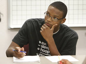 Photo - Freshman Blair Smith takes notes during math class at Oklahoma City Community College in June.  Photo By David McDaniel, The Oklahoman ARCHIVES