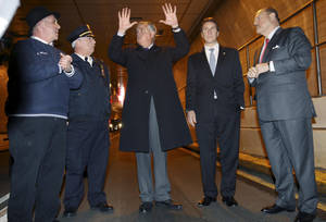 photo - <p>United States Secretary of Transportation Ray LaHood, center, New York Governor Andrew Cuomo, second from right, and MTA Chairman Joseph Lhota, right, speak with General Manager of the Hugh L. Carey tunnel Marc Mende, left, and Triborough Bridge and Tunnel Authority Chief of Operations Jim Fortunato in the Hugh L. Carey Tunnel, formerly the Brooklyn-Battery Tunnel, before a news conference in New York, Tuesday, Nov. 13, 2012. Cuomo announced the the tunnel, which was closed from damage caused by Superstorm Sandy, will open to limited traffic. (AP Photo/Seth Wenig)</p>