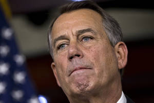 "photo - Speaker of the House John Boehner, R-Ohio, speaks to reporters about the fiscal cliff negotiations at the Capitol in Washington, Friday, Dec. 21, 2012. Hopes for avoiding the ""fiscal cliff"" that threatens the U.S. economy fell Friday after fighting among congressional Republicans cast doubt on whether any deal reached with President Barack Obama could win approval ahead of automatic tax increases and deep spending cuts kick in Jan. 1.  (AP Photo/J. Scott Applewhite)"