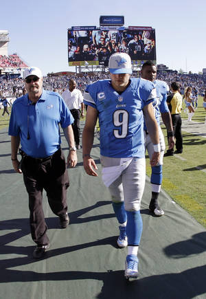 photo -   Detroit Lions quarterback Matthew Stafford (9) leaves the field after losing to the Tennessee Titans 44-41 in overtime at an NFL football game on Sunday, Sept. 23, 2012, in Nashville, Tenn. (AP Photo/Wade Payne)