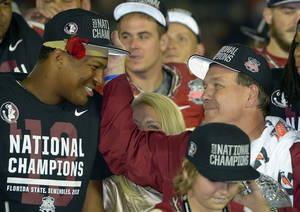Photo - Florida State head coach Jimbo Fisher with Jameis Winston after the NCAA BCS National Championship college football game against Auburn Monday, Jan. 6, 2014, in Pasadena, Calif. Florida State won 34-31. (AP Photo/Mark J. Terrill)