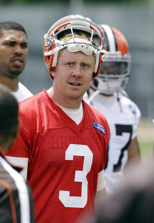 Photo - Cleveland Browns quarterback Brandon Weeden comes off the field after an off-season workout at the NFL football team's practice facility in Berea, Ohio Thursday, May 23, 2013. (AP Photo/Mark Duncan)