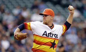 Photo - Houston Astros starting pitcher Brett Oberholtzer throws against the Seattle Mariners in the second inning of a baseball game Saturday, May 24, 2014, in Seattle. (AP Photo/Elaine Thompson)