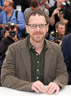 "This May 19, 2013 file photo shows film director and playwright Ethan Coen during a photo call for the film Inside Llewyn Davis at the 66th international film festival, in Cannes, southern France. The world premiere of Ethan Coen's first full-length stage play, a revival of ""The Threepenny Opera"" and a new play by Stephen Adly Guirgis will highlight the Atlantic Theater Company's upcoming season. Coen, half of the prolific filmmaking Coen brothers, offers his ""Women or Nothing,"" about two women desperate to have a child. It will be directed by David Cromer and begin performances Aug. 28.  (Photo by Joel Ryan/Invision/AP, file)"