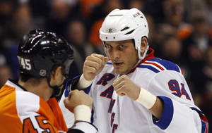 Photo -   FILE - In this Nov. 4, 2010, file photo, Philadelphia Flyers' Jody Shelley, left, and New York Rangers' Derek Boogaard fight during an NHL hockey game in Philadelphia. TMZ reported Friday night Sept. 21, 2012 that Boogaard's family is suing the union to collect the $4.8 million remaining on the contract for their son, who died last year, and an additional $5 million in punitive damages. (AP Photo/Matt Slocum, File)