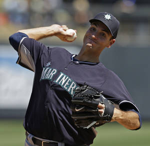 Photo - Seattle Mariners' Chris Young throws before the third inning of a spring exhibition baseball game against the Colorado Rockies on Saturday, March 29, 2014, in Scottsdale, Ariz. (AP Photo/Darron Cummings)