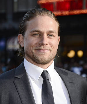 "Photo - Actor Charlie Hunnam arrives on the red carpet at the season six premiere screening of the television series ""Sons of Anarchy"" at the Dolby Theatre on Saturday, Sept. 7, 2013 in Los Angeles. (Photo by Dan Steinberg/Invision/AP)"
