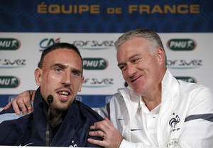 Photo - Head coach of the French national soccer team, Didier Deschamps, right, and Franck Ribery attend a press conference at the Stade de France in Saint Denis, outside Paris, Tuesday, Feb. 5, 2013. France  will play an international friendly soccer match against Germany in Saint Denis on Wednesday, Feb. 6. (AP Photo/Christophe Ena)