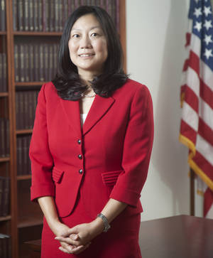 Photo - In this 2013 photo, U.S. District Judge Lucy Koh poses for a picture, in San Francisco. Koh has become increasingly frustrated during the first few days of the trial pitting Apple against Samsung because personal Wi-Fi signals interfere with an internal network she relies on for a real-time transcript of the proceedings. (AP Photo/The Recorder, Jason Doiy)