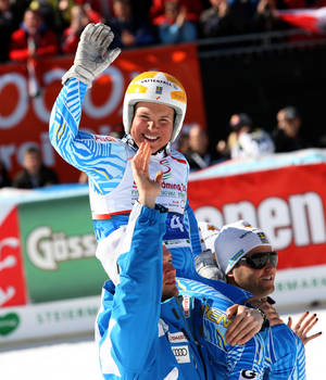 Photo - FILE - In this March 15, 2012 file photo, Sweden's Anja Paerson is carried on her teammates' shoulders after completing an alpine ski in the women's World Cup super-G in Schladming, Austria. Shortly after retiring in 2012, Paerson announced that she was in a long-term relationship with her girlfriend Filippa, ending years of speculation regarding her private life. Now she's working at the Sochi Olympics as an analyst for Swedish satellite TV provider Viasat and, since she's here, she doesn't mind discussing her opposition to Russia's laws against gay propaganda. (AP Photo/Armando Trovati, File)