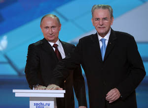 Photo - Russian President Vladimir Putin, left, and IOC President Jaques Rogge  press a symbolic button to mark One Year to the start of 2014 Winter Olympics, in Sochi, Russia, Thursday, Feb. 7, 2013.  (AP Photo/RIA-Novosti, Alexei Druzhinin, Presidential Press Service)