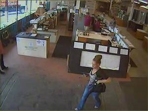 Photo - The woman wanted for questioning is show walking around the store where the fraudulent check was used. PHoto courtesy of the Oklahoma City Police Department <strong></strong>