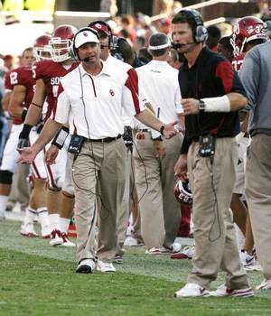 photo - OU coach Bob Stoops, left, worked with defensive coordinator Brent Venables at Kansas State before hiring him for the Sooners&#039; staff. PHOTO BY STEVE SISNEY, Oklahoman Archive &lt;strong&gt;STEVE SISNEY&lt;/strong&gt;