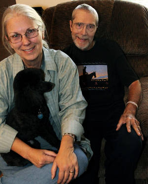 photo -   Phil Paschke, right, with his wife Marty and dog Jazz are pictured at their home in Lewisville, Texas, Friday Nov. 2, 2012. Phil is retiring as the coordinator of alcoholism ministry for the Diocese of Dallas. P (AP Photo/The Dallas Morning News, Louis DeLuca) MANDATORY CREDIT; MAGS OUT; TV OUT; INTERNET OUT; AP MEMBERS ONLY
