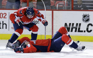 Photo - Washington Capitals center Mathieu Perreault, top, celebrates with left wing Wojtek Wolski, from Poland, after Wolski's goal in the first period of an NHL hockey game against the Florida Panthers on Thursday, March 7, 2013 in Washington. (AP Photo/Alex Brandon)