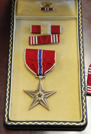 Photo - This bronze star is stored with other military service medals in the state treasurer's office vault along with other unclaimed property at the state Capitol in Oklahoma City.  PHOTO BY PAUL B. SOUTHERLAND, THE OKLAHOMAN