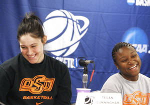 Photo - Oklahoma State's Tegan Cunningham, left, and Andrea Riley laugh during a news conference Sunday after Cunningham was asked about what it's like to have Riley back in the lineup. AP Photo