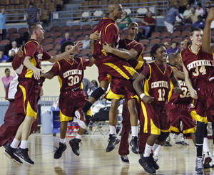 Photo - Centennial celebrates their win over Northeast after the championship game of the 3A boys state championship tournament at the Big House in the State Fair Park on Saturday, March 12, 2011, in Oklahoma City, Okla.  