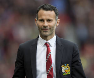 Photo - Manchester United's interim manager Ryan Giggs smiles as he takes to the touchline before his team's English Premier League soccer match against Norwich City at Old Trafford Stadium, Manchester, England, Saturday April 26, 2014. (AP Photo/Jon Super)