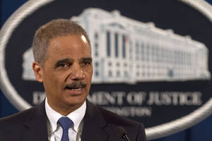 photo - Attorney General Eric Holder speaks at the Justice Department in Washington, Tuesday, Feb. 5, 2013. The U.S. government accused Standard & Poor's of inflating ratings on mortgage investments to boost its bottom line, taking aim at a key player in the run-up to the financial crisis.  (AP Photo/Jacquelyn Martin)