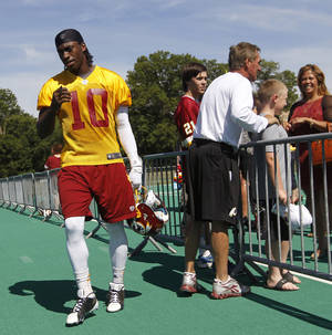 Photo -   Washington Redskins quarterback Robert Griffin III, left, walks past head coach Mike Shanahan, right, following NFL football practice at Redskins Park in Ashburn, Va., Wednesday, June 13, 2012. (AP Photo/Pablo Martinez Monsivais)
