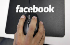 """Photo - Would you """"unfriend"""" someone on Facebook if you didn't like the opinions they post? AP PHOTO/PAUL SAKUMA <strong>Paul Sakuma</strong>"""