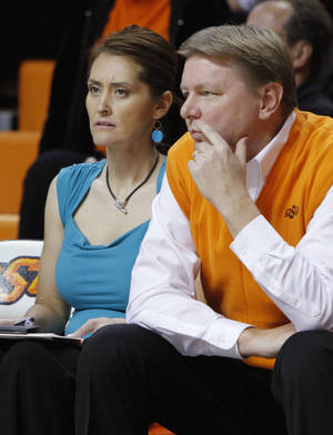 Photo - Oklahoma State women's basketball coach Kurt Budke and his assistant coach Miranda Serna watch their team during an exhibition game Nov. 9, 2011, just days before they died in a plane crash.  Photo by Bryan Terry,  The Oklahoman Archives