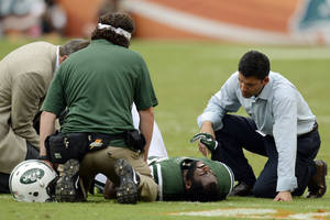 photo -   FILE - In this Sunday, Sept. 23, 2012 file photo, New York Jets trainers attend to cornerback Darrelle Revis (24) during the second half of an NFL football game against the Miami Dolphins, in Miami. Revis has a torn anterior cruciate ligament in his left knee that will require surgery, likely meaning he'll miss the rest of the season, the team announced Monday, Sept. 24. (AP Photo/Rhona Wise, File)