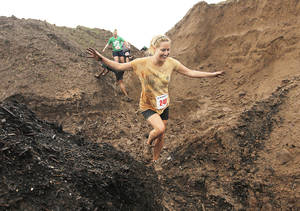 Photo - Lori Branson, of Oklahoma City, participates during the Red Mud Run on the property of K&M Demolition in Oklahoma City, Sunday, May 20, 2012.  Photo by Garett Fisbeck, For The Oklahoman