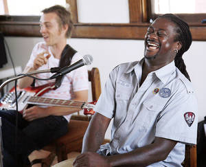 Photo - Percussionist Arthur Thompson, right, laughs at a comment by bassist Matt Hayes during a jazz clinic  Saturday at the Santa Fe Depot. The clinic was held in conjunction with the annual Jazz in June festival.  For story, see Page 10A. PHOTO BY NATE BILLINGS, THE OKLAHOMAN