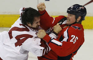 Photo -   Phoenix Coyotes center Kyle Chipchura (24) fights with Washington Capitals left wing Matt Hendricks (26) during the first period of an NHL hockey game in Washington, Monday, Nov. 21, 2011. Both players received major penalties for fighting. (AP Photo/Ann Heisenfelt)