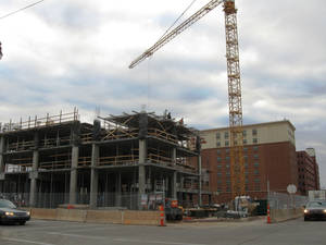 photo - Construction continues Friday on the 11-story Hilton Garden Inn/Homeward Suites at 328 E Sheridan Ave. The hotel is one of two being built in or around Bricktown, with five others to be built over the next two years. <strong> - STEVE LACKMEYER</strong>