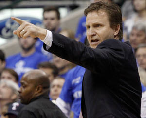 photo - Oklahoma City coach Scott Brooks shouts instructions during game 2 of the Western Conference Finals in the NBA basketball playoffs between the Dallas Mavericks and the Oklahoma City Thunder at American Airlines Center in Dallas, Thursday, May 19, 2011. Photo by Bryan Terry, The Oklahoman