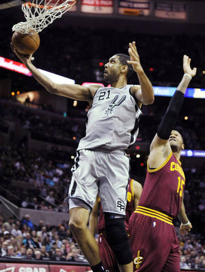 Photo - San Antonio Spurs forward Tim Duncan (21) shoots in front of Cleveland Cavaliers forward Marreese Speights during the first half of an NBA basketball game, Saturday, March 16, 2013, in San Antonio. (AP Photo/Bahram Mark Sobhani)