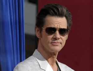 "Photo - FILE - This March 11, 2013 file photo shows actor Jim Carrey at the world premiere of ""The Incredible Burt Wonderstone"" at the TCL Chinese Theatre in Los Angeles. Carrey says that he ""cannot support"" the violence in his upcoming superhero action flick ""Kick-Ass 2"" in the wake of the Sandy Hook Elementary School massacre.  The actor tweeted Sunday, June 23, that, after shooting the film last year before the Connecticut tragedy, ""now in good conscience I cannot support that level of violence."" Carrey added that he wasn't ashamed of the film ""but recent events have caused a change in my heart."" ""Kick-Ass 2"" is a sequel to the 2010 action comedy whose breakout star was the 11-year-old vigilante Hit-Girl, played by Chloe Grace Moretz. She reprises the role in the sequel, which Universal Pictures will release August 16. Carrey plays an upstart, superhero-costume wearing vigilante named Colonel Stars and Stripes.  (Photo by Dan Steinberg/Invision/AP, file)"