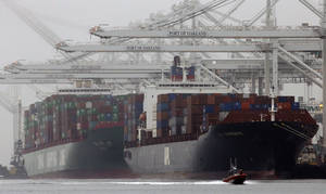 Photo - FILE - In this Wednesday, Oct. 23, 2013, file photo, container ships wait to be off loaded in a thick fog in Oakland, Calif.  The government reports on the U.S. trade deficit for October on Wednesday, Dec. 4, 2013. (AP Photo/Ben Margot, File)