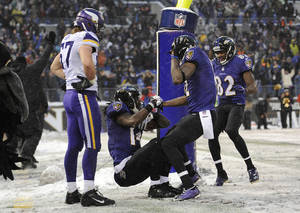 Photo - Baltimore Ravens wide receiver Marlon Brown, center, celebrates his touchdown with teammates Jacoby Jones, second from right, and Torrey Smith in front of Minnesota Vikings middle linebacker Audie Cole in the second half of an NFL football game, Sunday, Dec. 8, 2013, in Baltimore. Baltimore won 29-26. (AP Photo/Nick Wass)