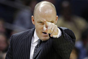photo - FILE - This Nov. 19, 2012 file photo shows Milwaukee Bucks head coach Scott Skiles directing his team against the Charlotte Bobcats during the second half of an NBA basketball game in Charlotte, N.C. Skiles is out as Bucks head coach and the team says assistant Jim Boylan will take over for the rest of the season. Bucks general manager John Hammond made it official Tuesday, Jan. 8, 2013. (AP Photo/Chuck Burton, File)